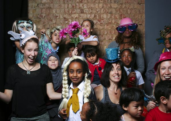 Children and adult posing in a photobooth